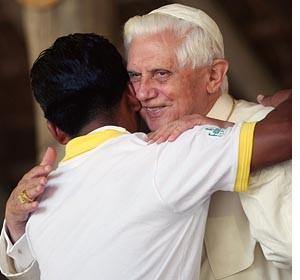 Pope Benedict XVI greets a young person in Brazil