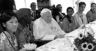 Pope John Paul II at lunch with young friends